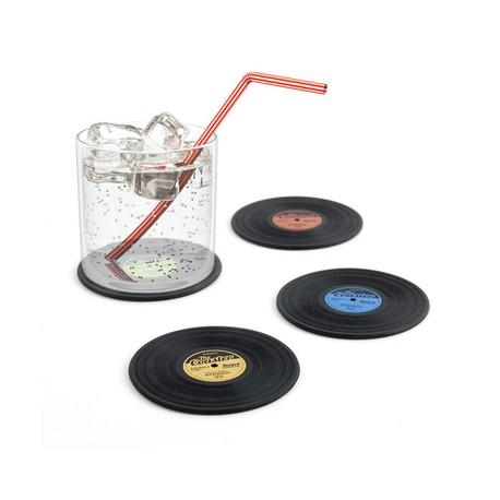 Porta vasos con diseño de disco.